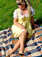 Angel in a Wiesn Dirndl and Pantyhose