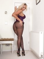Glamour puss Lucy in a micro mini dress and slinky black pantyhose!