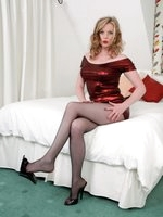 Leggy Holly in dangerously short glamour dress and black pantyhose!