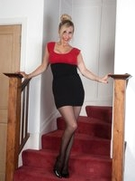 Essex girl Saffy in mini dress and sheer black pantyhose.