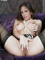 Racy, dizzy, Mercedes stripping and spreading black nyloned legs!