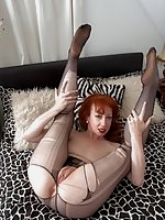 Red is ready for some naughty nylon fun on the bed!