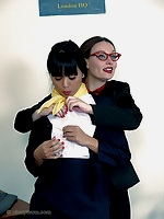 Two naughty office girls fall out in the office and decide to teach each other a naughty lesson.
