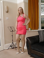 Hot blonde shows off her curvy body and shapely legs in a gorgeous pink dress and dazzling white stilettos