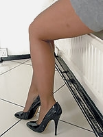 Super foxy Kathryn will have you purring once again when you cum up close to see her long stockinged legs and shiny heels