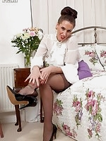 Tammy, rubbing her long legs together in black ff stockings!