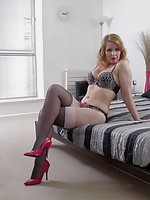 Horny Milf Jenny is waiting to seduce you on the bed in her sexy lingerie, stockings and high heels