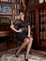 Raven Lee in her black stockings and multi-strap garter