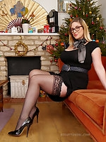 Heidi in silky nylons and black shiny stilettos