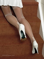 Taya wears her shoes with white stockings to receive your love