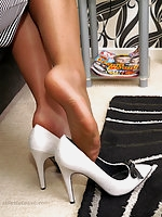 Michelle makes sure that her feet are never out of her high heels