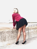 Gorgeous leggy blonde Naomi teases outdoors in a cute black summer dress