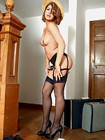 Lizzie Gibson in stockings and uniform