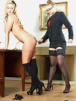 Stephanie Wright, Deputy Headmistress Drogan in stockings and uniform