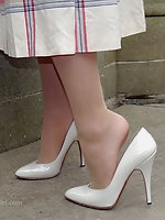 Sophia poses in a lovely white pair of high heel stilettos