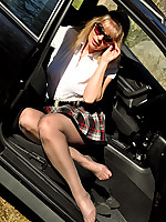 Angel in brown shiny Pantyhose in the car